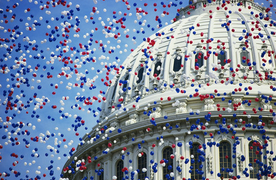 This is the U.S. Capitol during the Bicentennial of the Constitution Celebration. There are red, white and blue balloons falling around the Capitol Dome. It marks the dates that commemorate the Centennial 1787-1987.