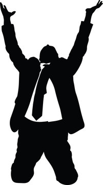 Silhouette of a businessman in a suit on his knees and begging with raised arms.