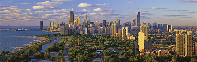 Poster Chicago This is Lincoln Park with Diversey Harbor in the foreground and Lake Michigan on the left looking south. It shows the skyline in morning light in the summer. The John Hancock Building is fairly prominent toward the left hand side.
