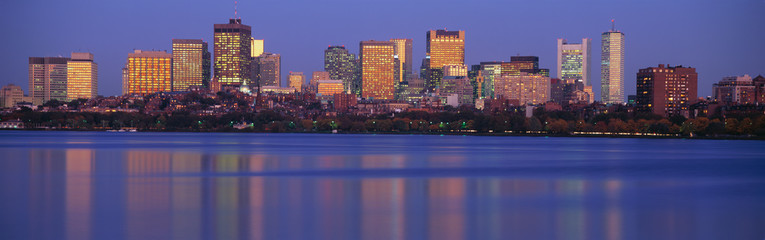 This is the State Capitol and skyline along the Charles River. It is the view from Harvard Bridge at sunset.