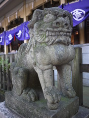 Guardian dog of stone statue at Kushida Shrine