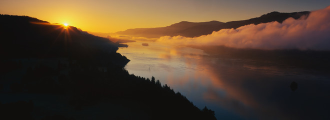 This is Cape Horn on the Columbia River Gorge at sunrise. There is a morning mist over the river.