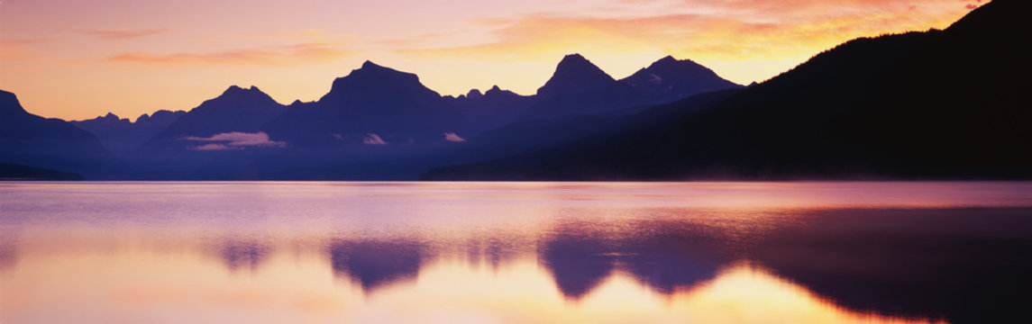 This is Lake McDonald. There is a reflection of the mountains in the lake.