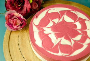 Raspberry yoghurt cheese cake on wooden table/ Close up image