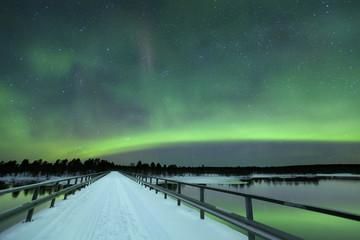 Wall Mural - Aurora borealis over a bridge in winter, Finnish Lapland
