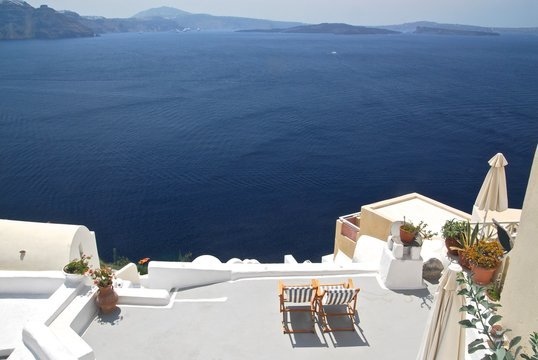 Two chairs on terrace with a stunning seaview on Santorini caldera