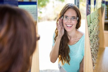 Pretty woman shopping for new glasses