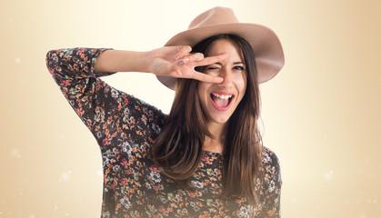 Cute woman doing victory gesture