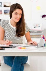 Portrait of young woman in the office