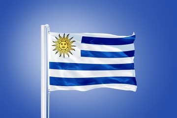 Flag of Uruguay flying against a blue sky