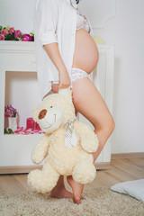 Pregnancy and  fleecy bear toy
