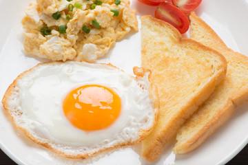 Deurstickers Gebakken Eieren fresh fried egg and scrambled egg with bread for breakfast