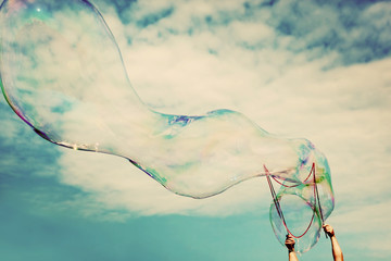 Blowing big soap bubbles in the air. Vintage freedom, summer concepts.