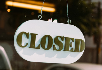 closed sign on glass door
