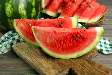 Slices of ripe watermelon on wooden table close up