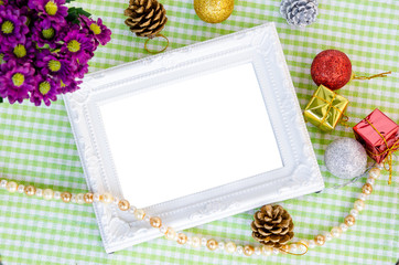 Vintage white photo frame with christmas decoration with flower.