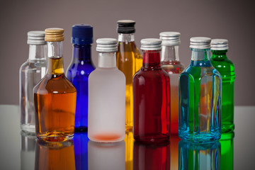Group of colorful little bottles