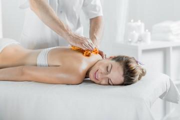 Beautiful female during body treatment