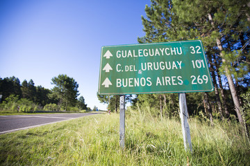 Mileage sign on the road with distances to Buenos Aires, Uruguay