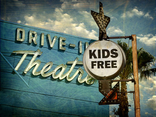 aged and worn vintage photo of drive in theater kids free sign
