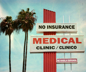 aged and worn vintage photo of medical clinic sign