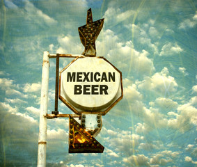 aged and worn vintage photo of mexican beer sign