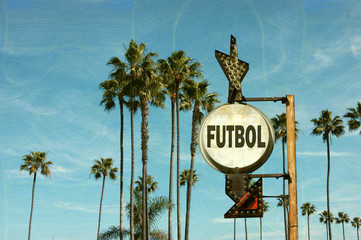 aged and worn vintage photo of futbol (football) sign with palm trees
