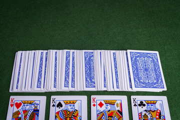 Split pack of playing cards showing Kings