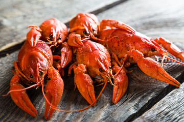 boiled crayfish on a wooden table
