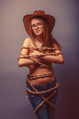 Obraz European-looking girl of twenty years in glasses wrapped with ro - fototapety do salonu