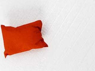 red pillow on the floor
