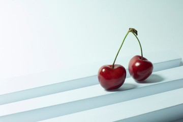 blue background with cherries