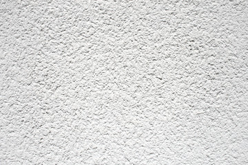 White coarse rough plaster material found on a house wall, texture material