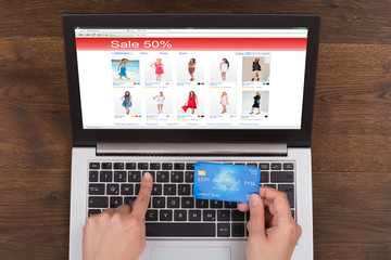 Person Shopping Online With Credit Card And Laptop
