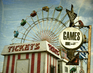 aged and worn vintage photo of retro carnival with games sign