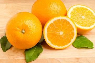 Navel orange fruit on wooden background