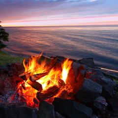 Sunset camp fire along the beach of Lake Superior in Michigan