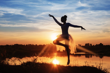 Silhouette of a Ballet Dancer at Sunset Outdoors