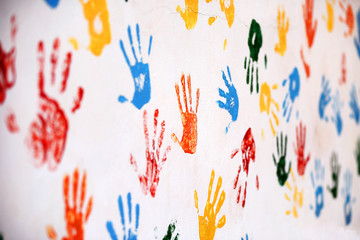 Wall with colored prints of human hand