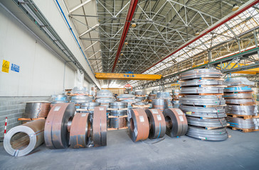 Metal coils in industrial warehouse