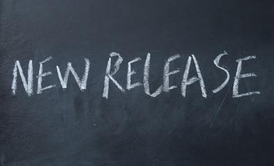 new release text write on blackboard