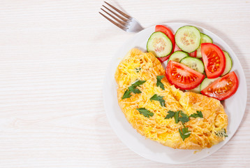 Omelet with cheese and vegetables