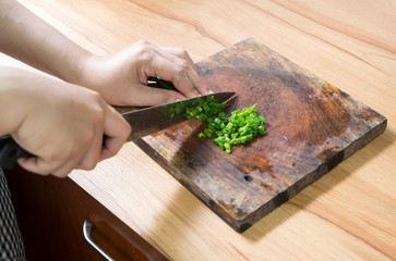 woman sliced vegetables on the cutting board
