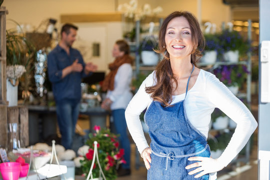 Portrait Of Smiling Female Owner At Flower Shop