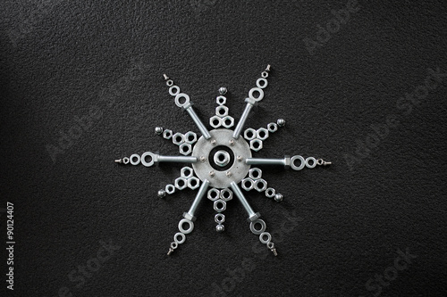 Star symbol made by screw nuts, washers and bolts