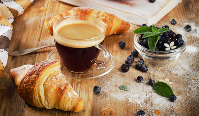 Cup of Coffee and croissants for  healthy breakfast