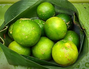 Fresh Limes In Banana Leaf Packaging