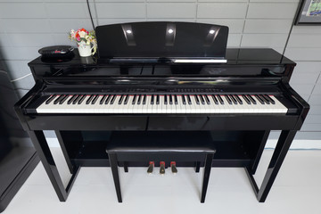 A black electronic piano