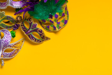 Mardi Gras Mask on yellow Background Wall mural