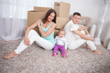 Cute family is packing objects for cross-over